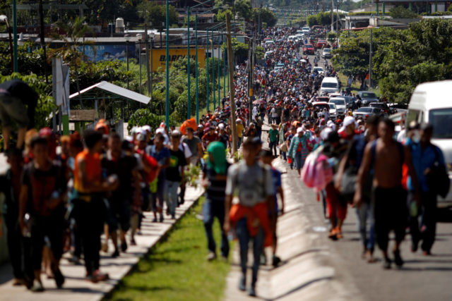 Central American migrants walk along the highway near the border with Guatemala, as they continue their journey trying to reach the U.S., in Tapachula, Mexico October 21, 2018. REUTERS/Ueslei Marcelino TPX IMAGES OF THE DAY - RC1A8C0D9D30